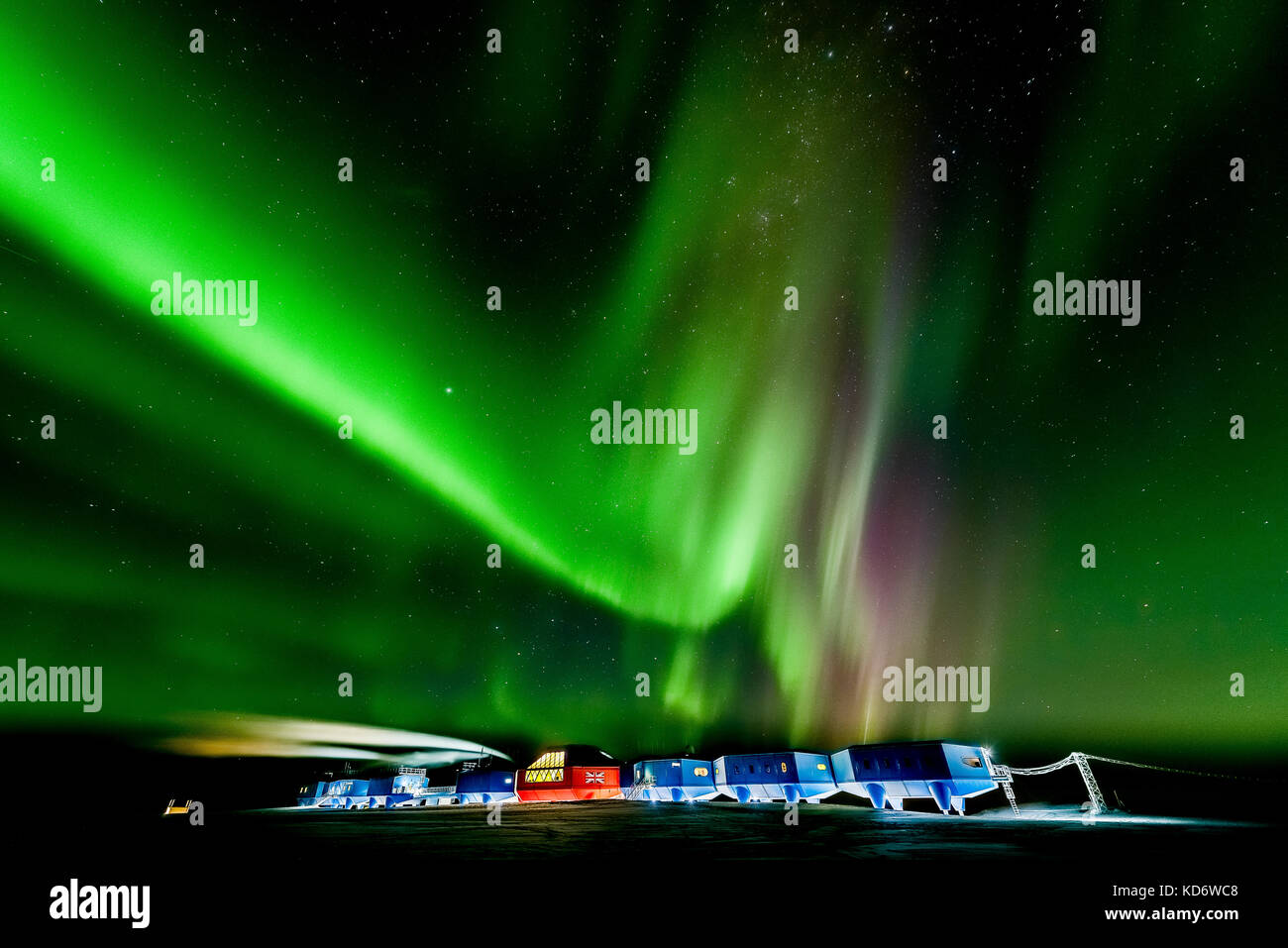 The bright Aurora Australis puts on a show over the Halley Research Station in Antarctica. This photograph was taken - Stock Image