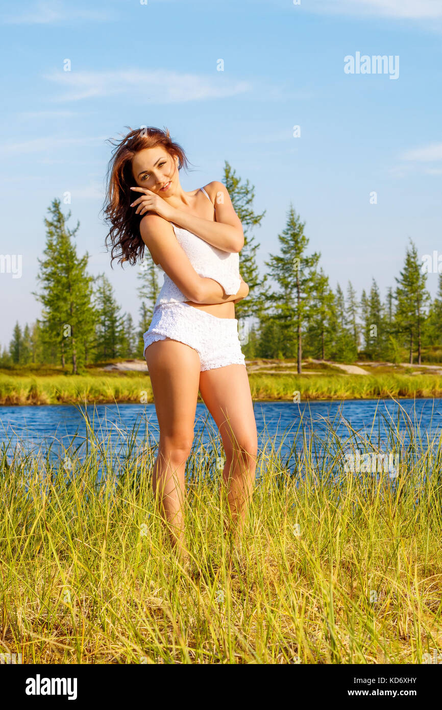 Pretty young girl near the river - Stock Image
