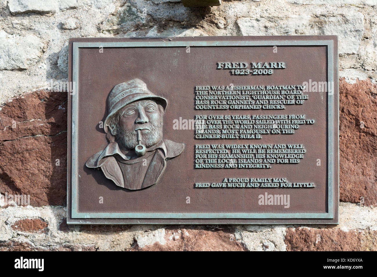 Memorial plaque for local fisherman Fred Marr North Berwick harbour, East Lothian, Scotland, UK - Stock Image