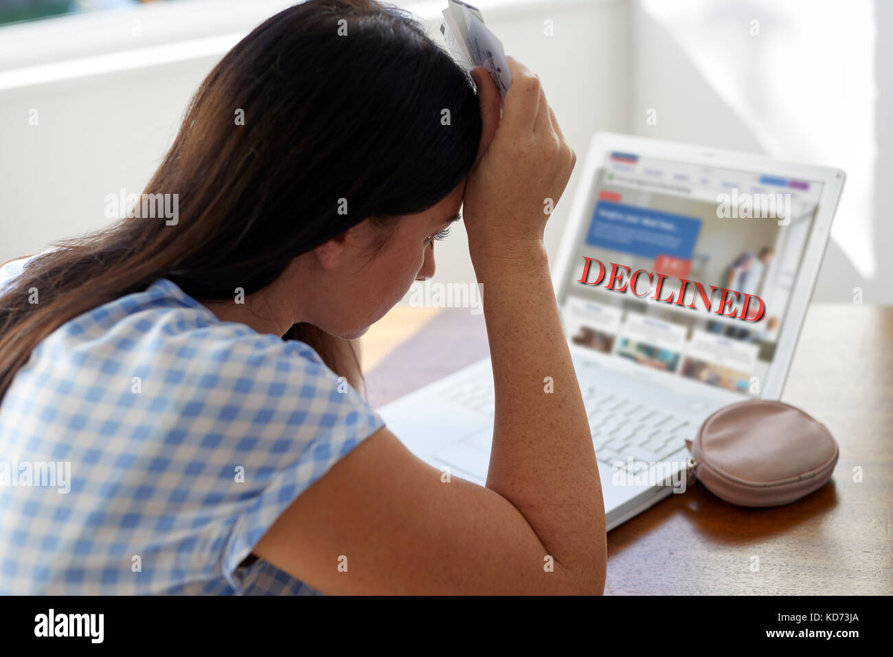 Woman with account being declined - Stock Image