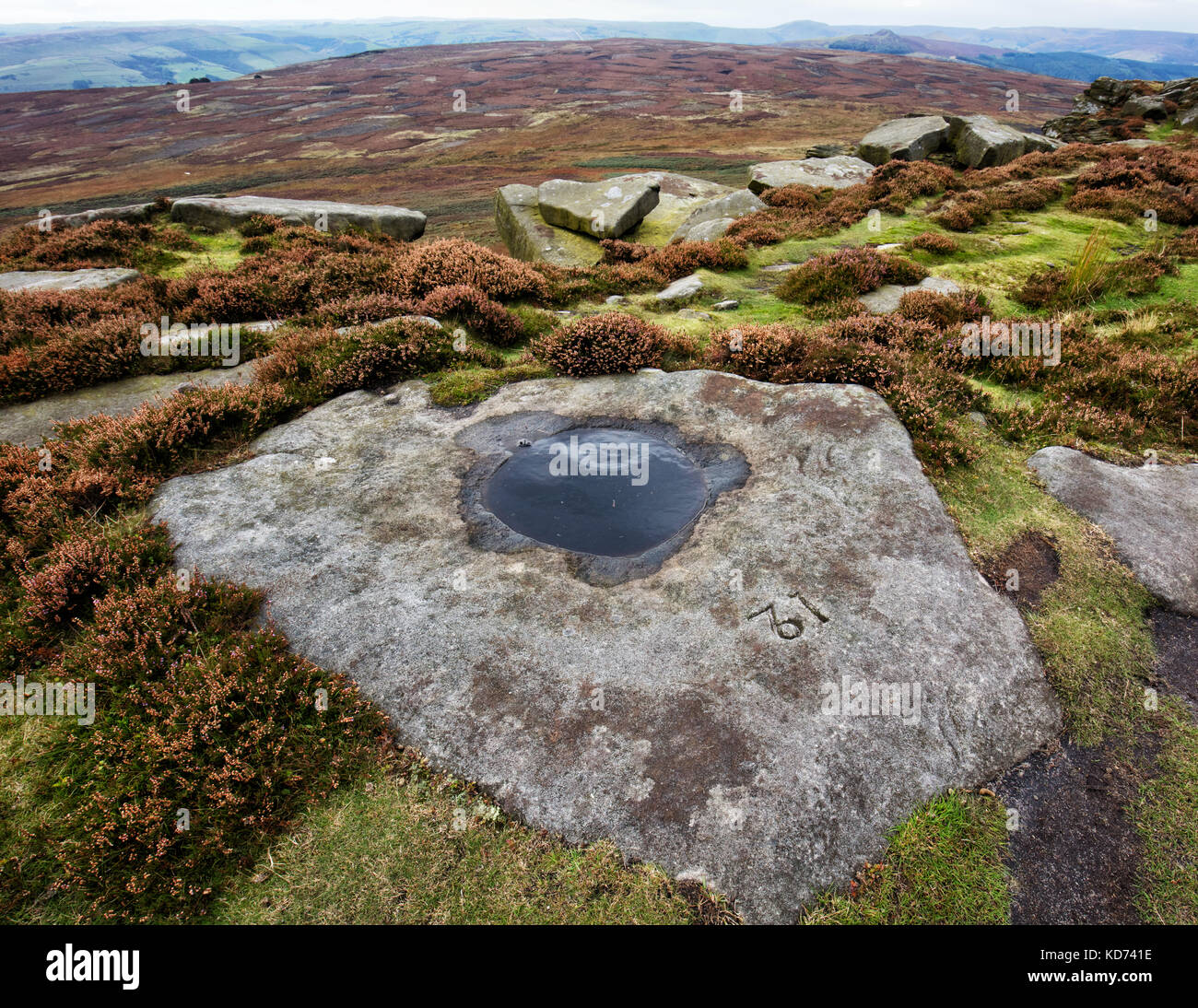 Numbered carved rock basin on Stanage Edge near Hathersage in the Derbyshire Peak District - made to supply water - Stock Image