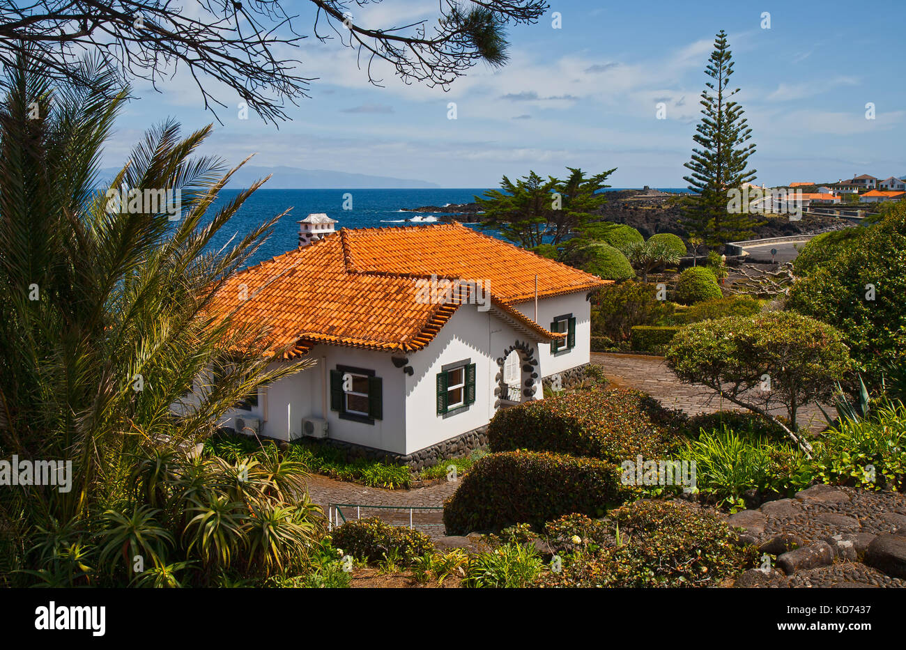 The white stone house with a tile roof on seacoast stock image
