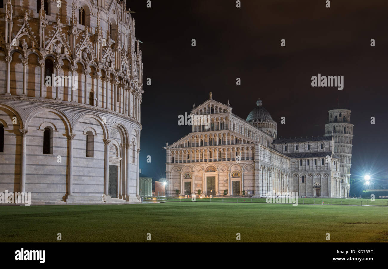 The world famous Piazza dei Miracoli by night in Pisa, Tuscany.  The construction of the cathedral was begun in Stock Photo