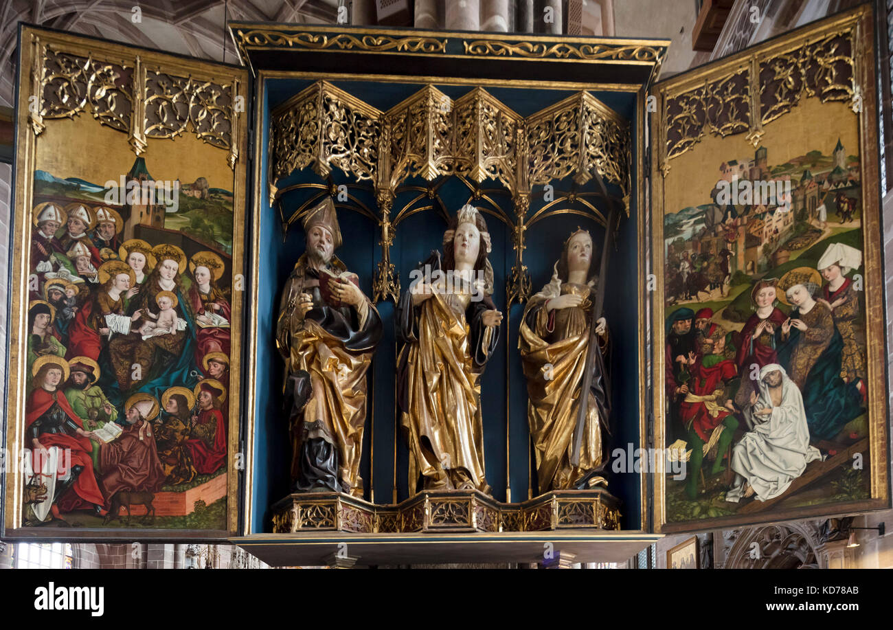 Altar of St Catherine, from workshop of Michael Wolgemut, c1485-90. The Saint is flanked by Saints Livinus and Helen. - Stock Image