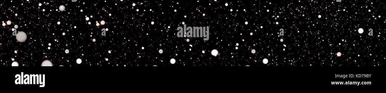 abstract background panorama of falling snow. white snowflakes on a black background panoramic view. design element - Stock Image