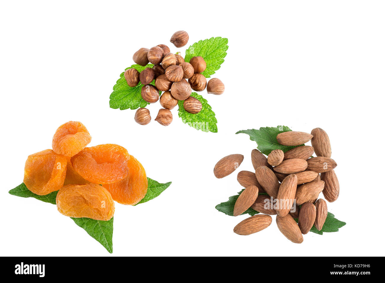 almonds, walnut, dry raisin, dried apricots in one collection on white - Stock Image