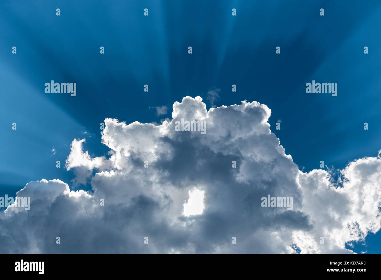 Sun rays and cloud. - Stock Image
