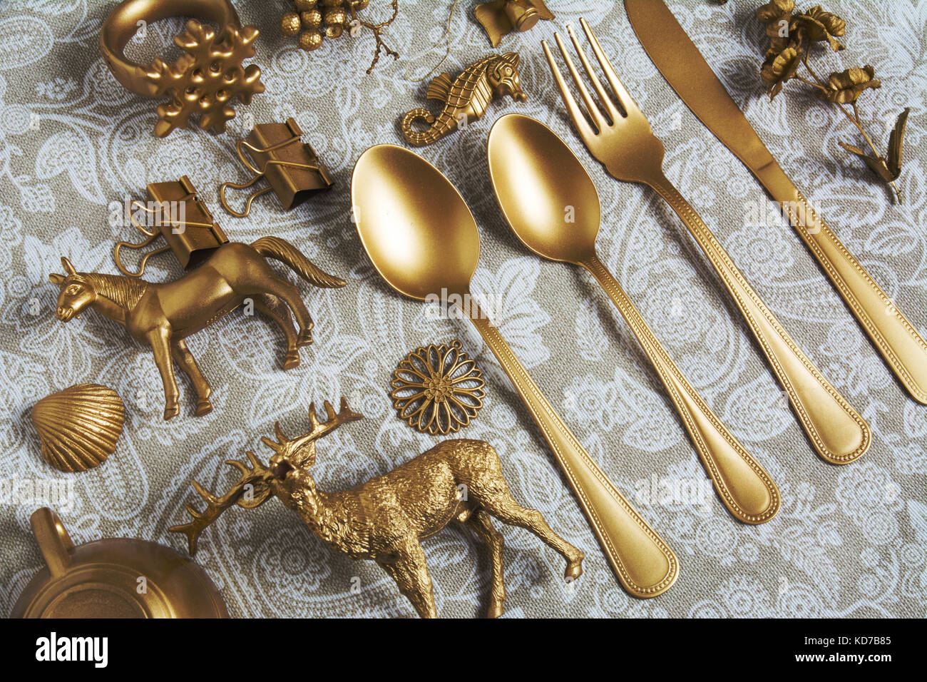 Gold cutlery and decorative Christmas ornaments - Stock Image