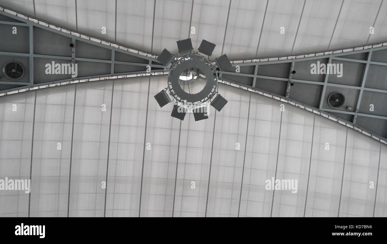 Big ceiling lamp for large hall. Modern layered ceiling with embedded lights and stretched ceiling inlay, lights Stock Photo