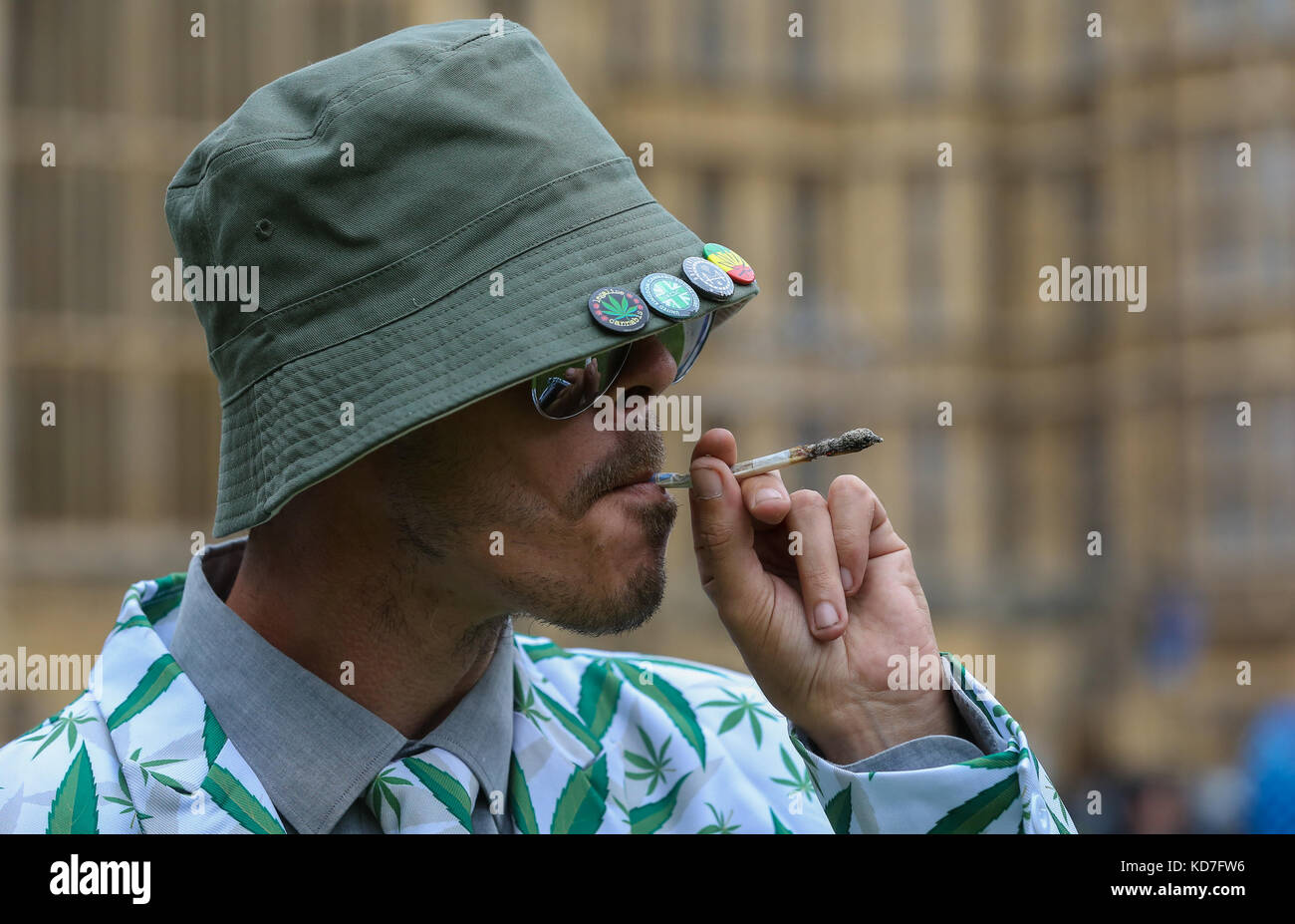 Westminster. London, UK. 10th October, 2017. A man smokes cannabis during the tea party. The protest organised by Stock Photo
