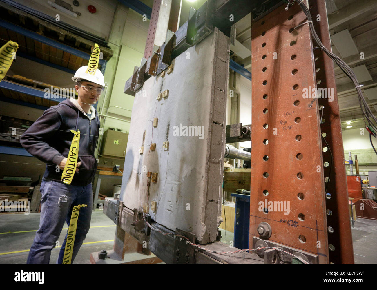 Vancouver. 10th Oct, 2017. A researcher checks on a concrete wall coated with eco-friendly ductile cementitious - Stock Image