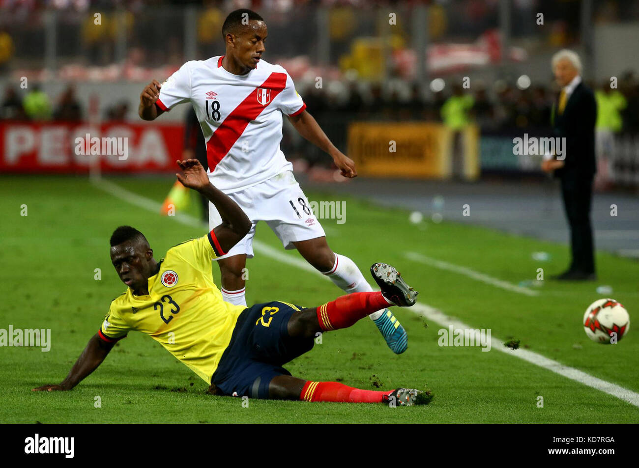 bcbacd723 Peru s Andre Carrillo (Back) vies for the ball with Colombia s Davinson  Sanchez (Front) during the Russia 2018 FIFA World Cup qualifier match