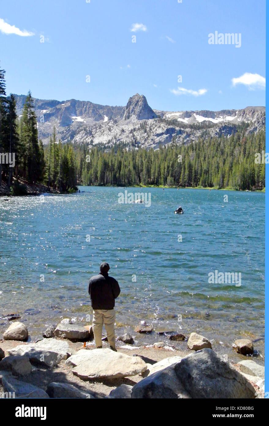 Man fishing in october on june lake ca Stock Photo