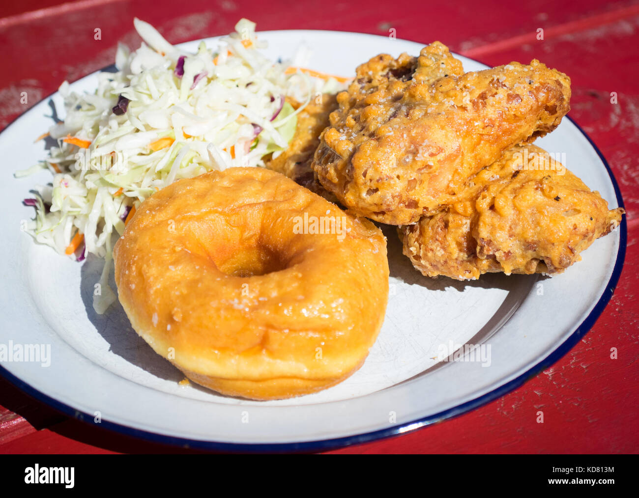 Fried chicken and donuts (fried chicken and donut) from Have Mercy, a popular US southern food restaurant in Edmonton, - Stock Image