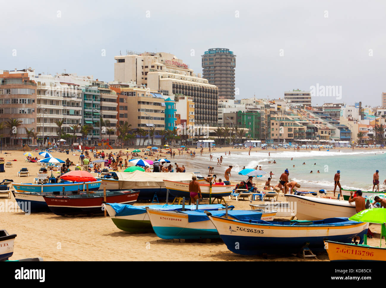 Las Palmas, Spain - July 1, 2011: Spanish families and tourists enjoying hot day at crowded beach of Las Canteras, - Stock Image