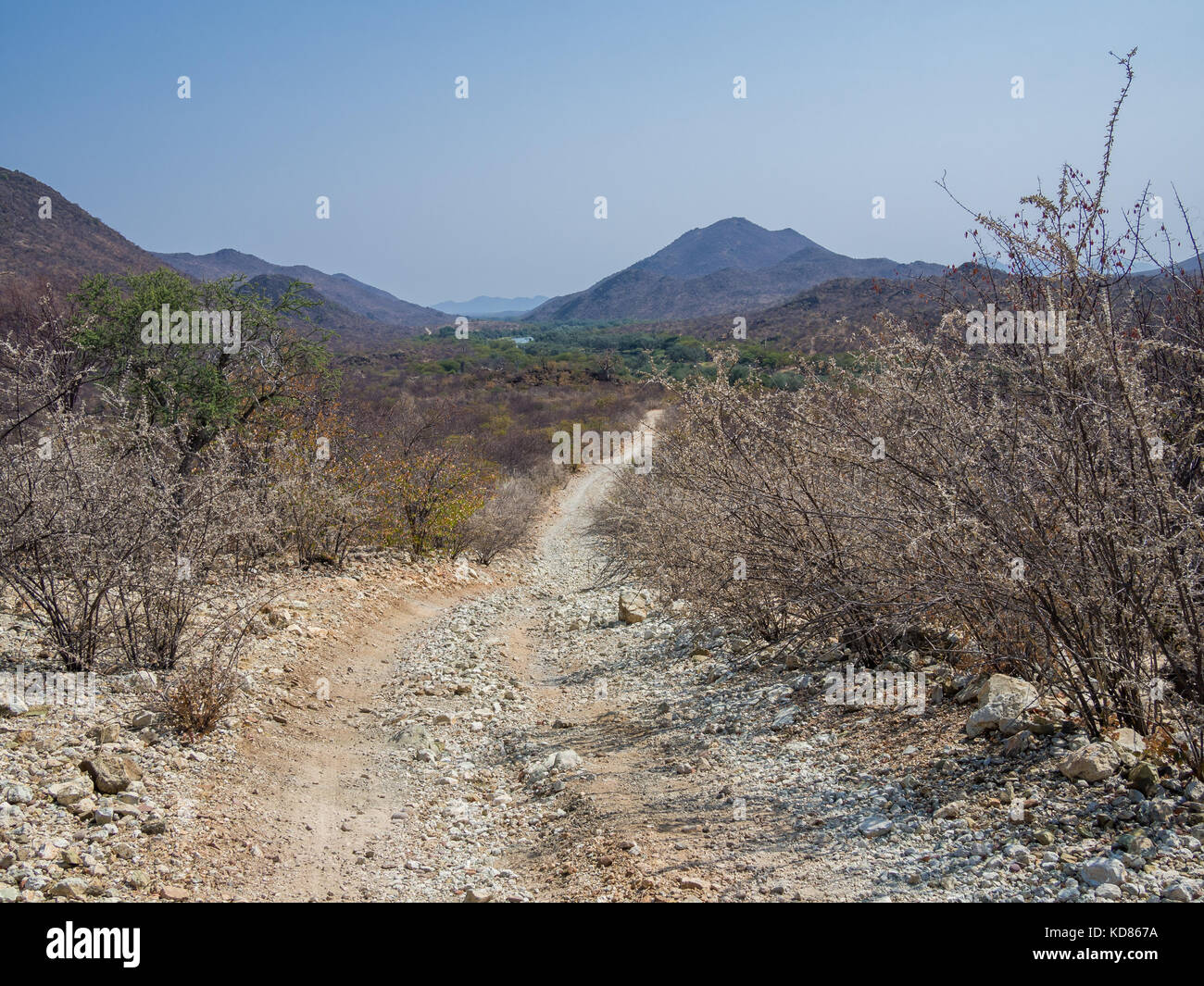 Very rough offroad track with large rocks and ruts leading along Kunene River between Kunene River Lodge and Epupa - Stock Image
