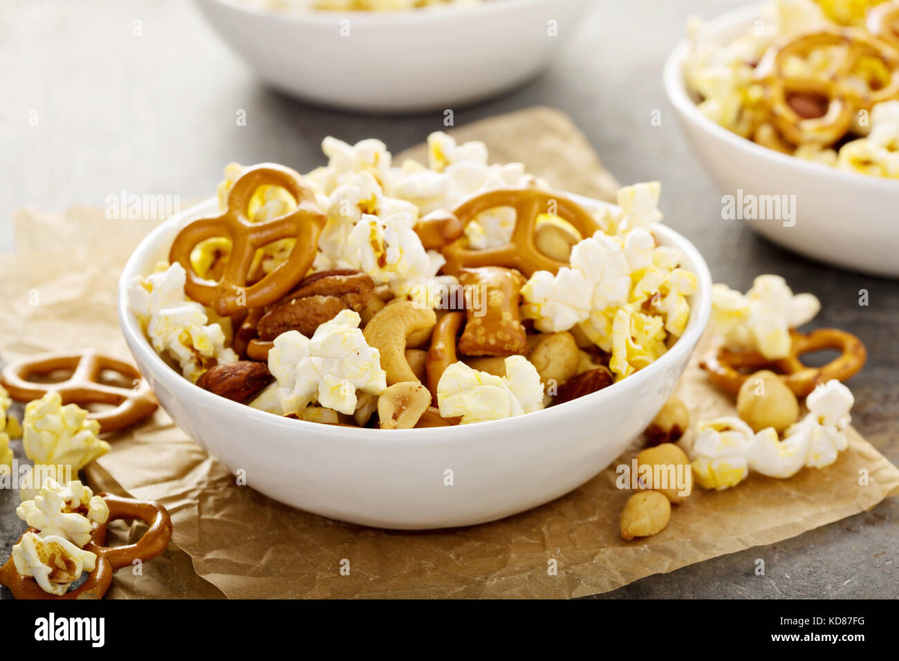 Homemade trail mix with popcorn, pretzels and nuts - Stock Image