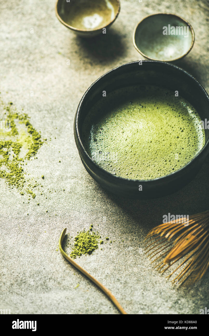 Flat-lay of freshly brewed Japanese matcha tea in Chasen bowl, selective focus - Stock Image
