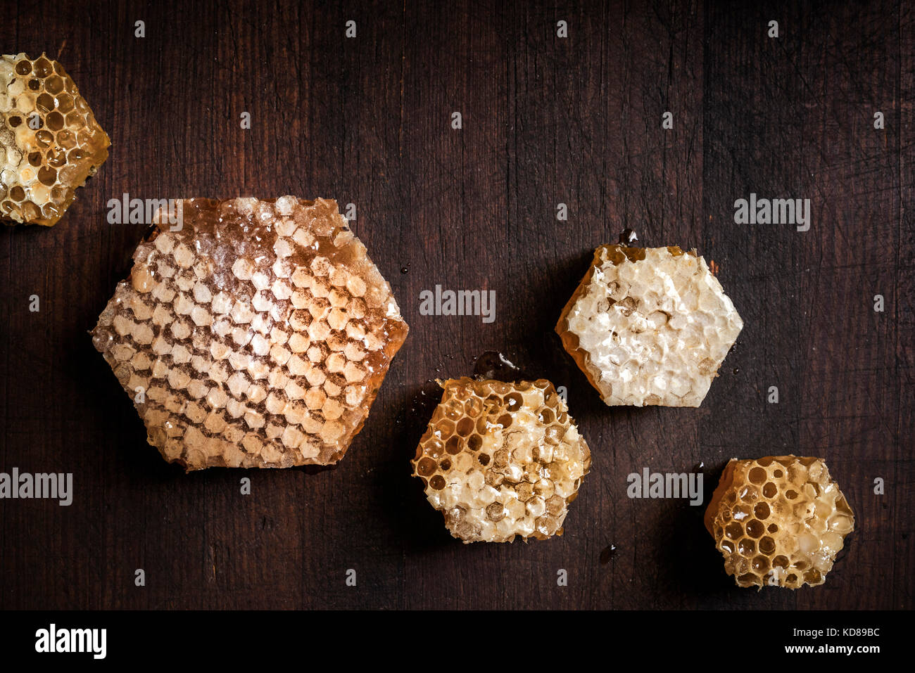 Large pieces of fresh honeycomb cut into hexagon shapes. - Stock Image