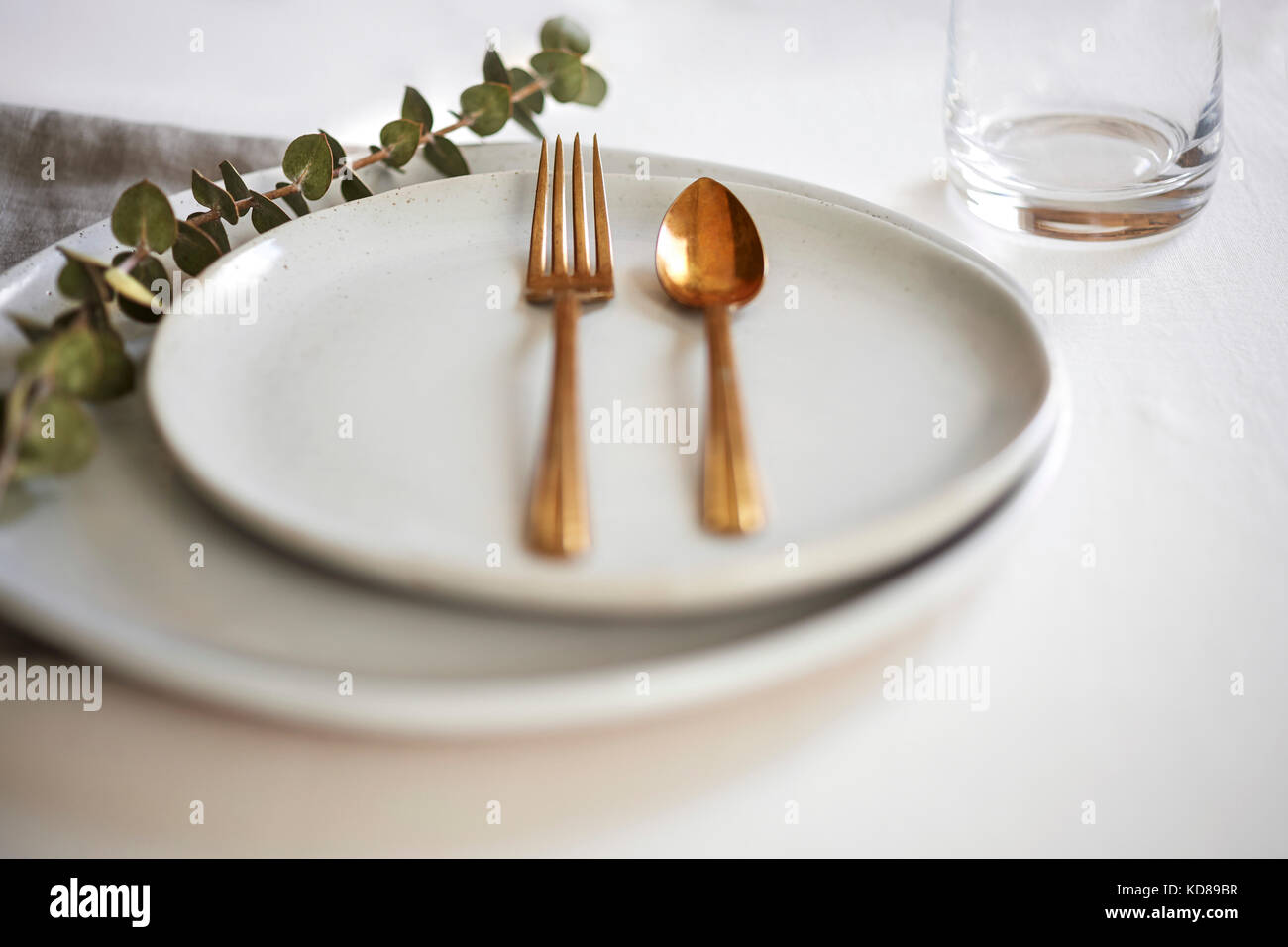 Minimal Table Setting With Handmade Off White Plates Gold Silverware Stock Photo Alamy