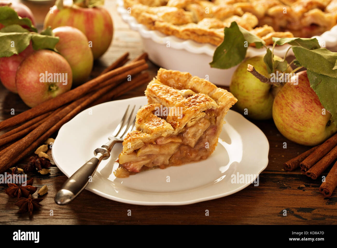 Piece of an apple pie on a plate - Stock Image