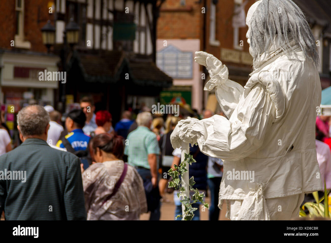Street Artist / Living Statue performing as the Ghost of William Shakespeare for passing tourists, Henley Street, - Stock Image