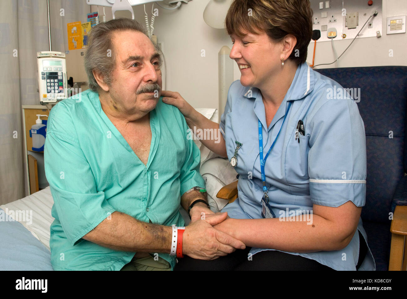 Claire Thomas with Bill Hardingham, who she assisted when he collapsed outside her home, together in the Royal United - Stock Image