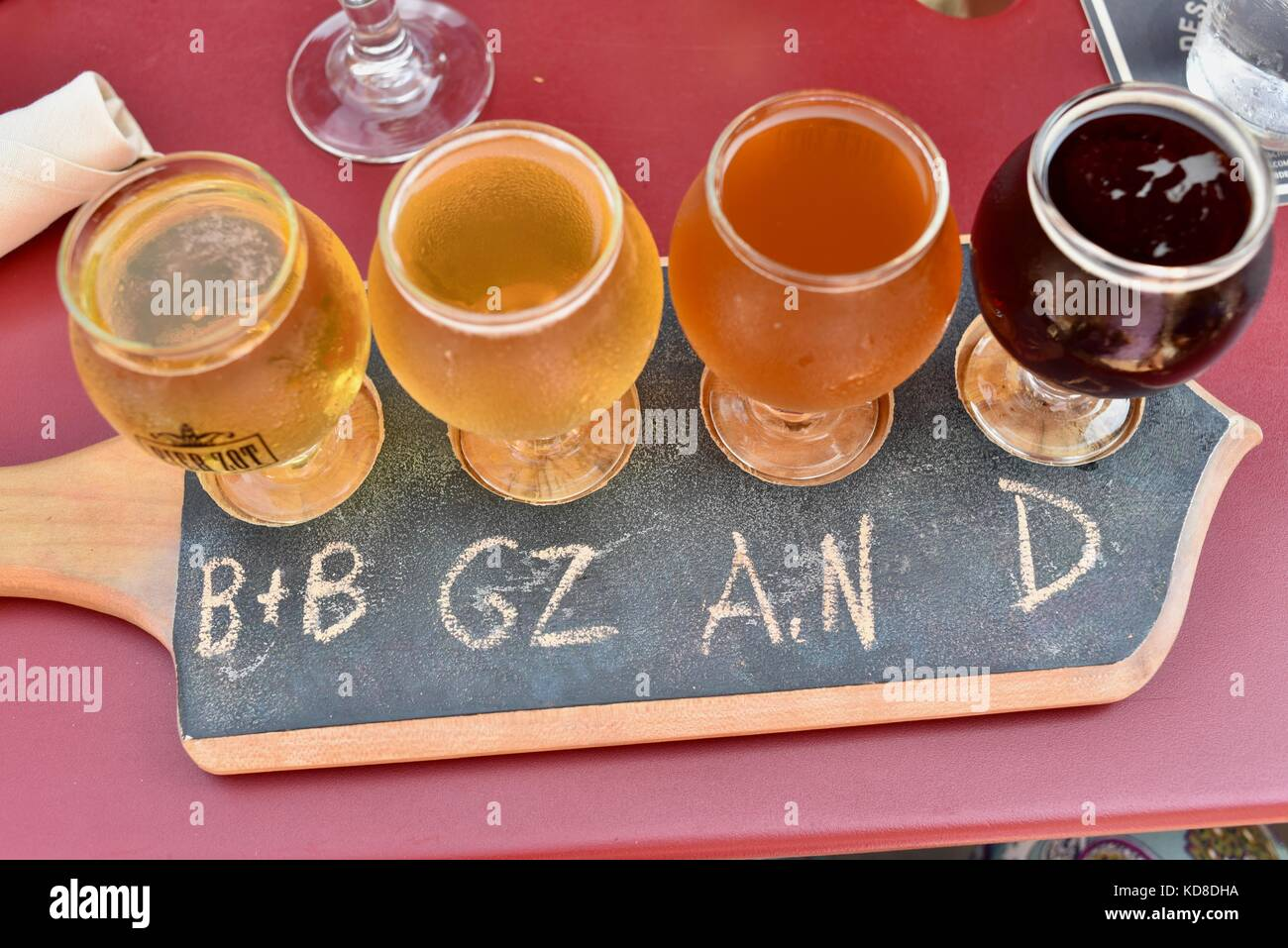 Beer sampling flight with different styles and types of beers offered at Bier Zot in Door County community of Sister - Stock Image