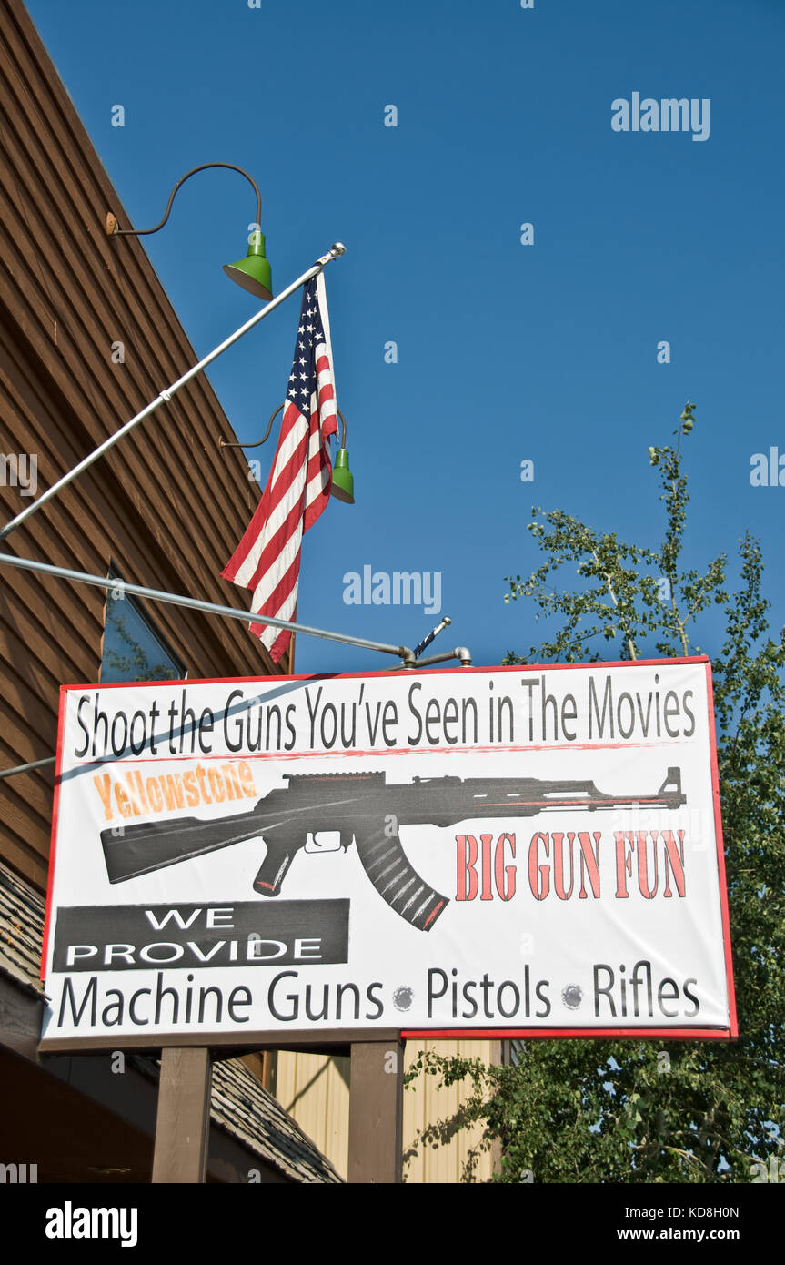 Gun shop sign in West Yellowstone, firearms regulation concept - Stock Image