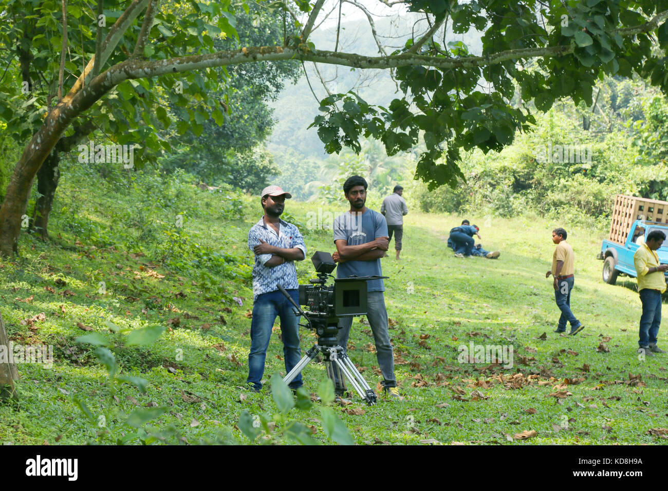 Camera man and camera operator looking on outside, film shooting spot - Stock Image