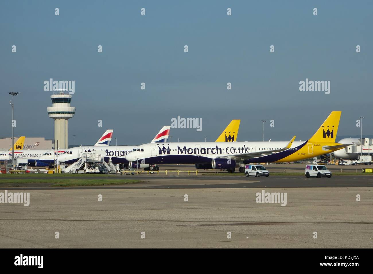 Monarch and British Airways aircraft on the tarmac at London Gatwick Airport, England, UK - Stock Image
