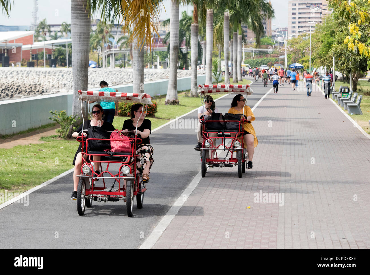 Four wheel fun bicycle carts in the traffic free area on Sunday in Panama City - Stock Image