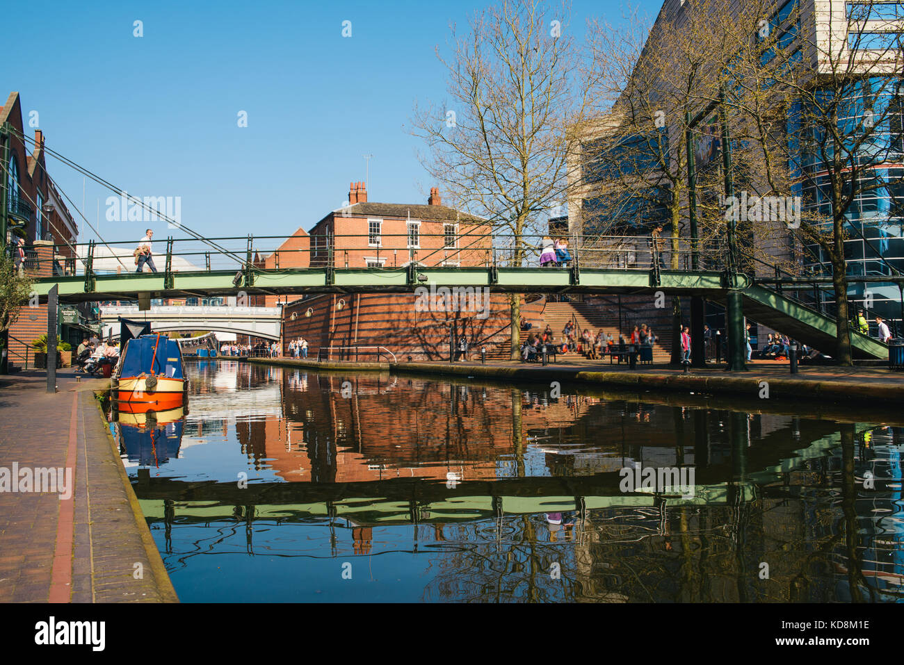 People strolling along Birmingham's main canal on a pleasant morning - Stock Image