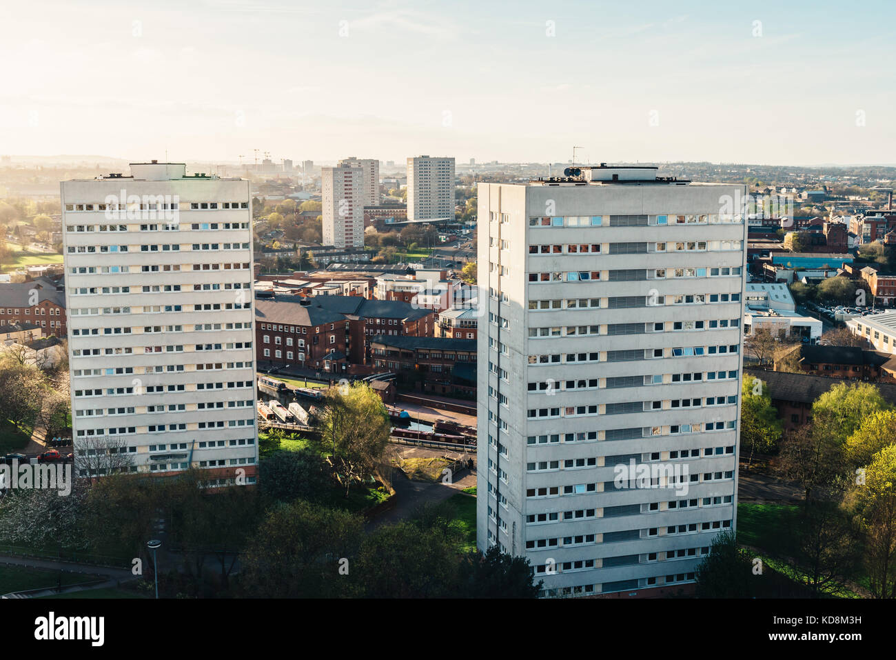 Aerial view of one of Birmingham's historic canals alongside tower blocks - Stock Image