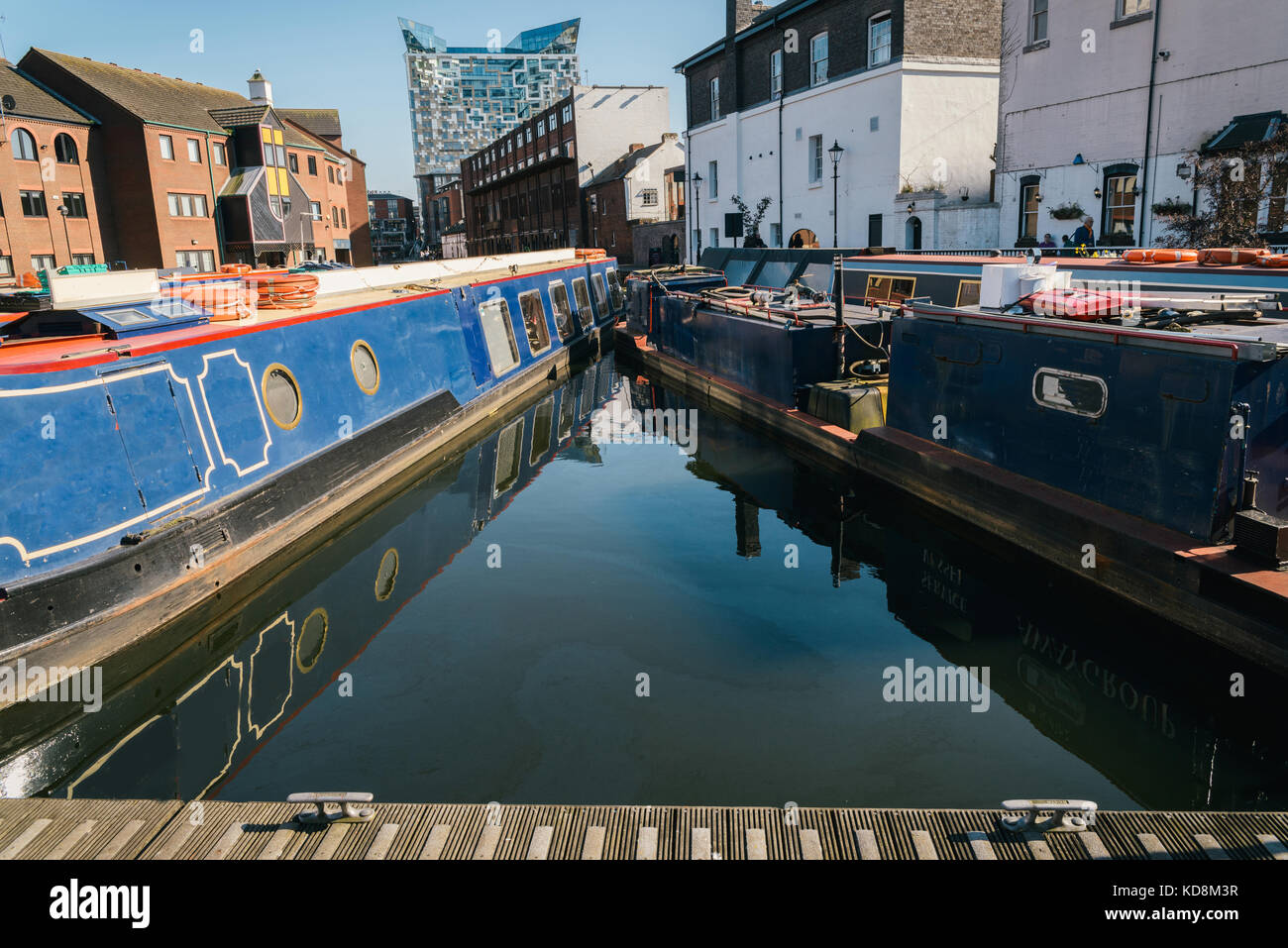Canal on Gas Street Basin in the heart of Birmingham looking towards the Mailbox and Cube building Stock Photo