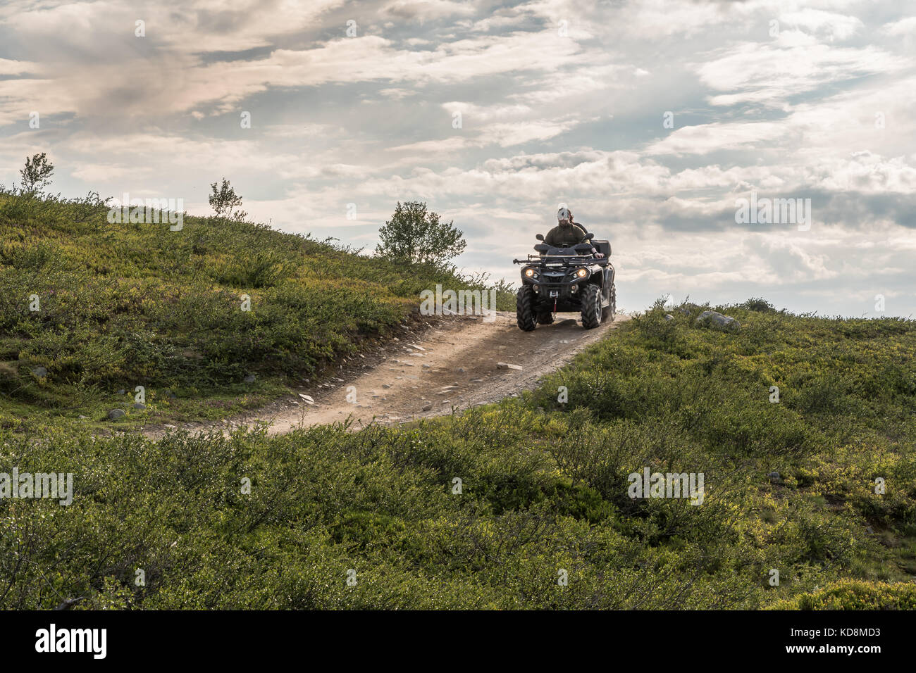 ATV driving at a mountain trail in Finnmark Norway - Stock Image