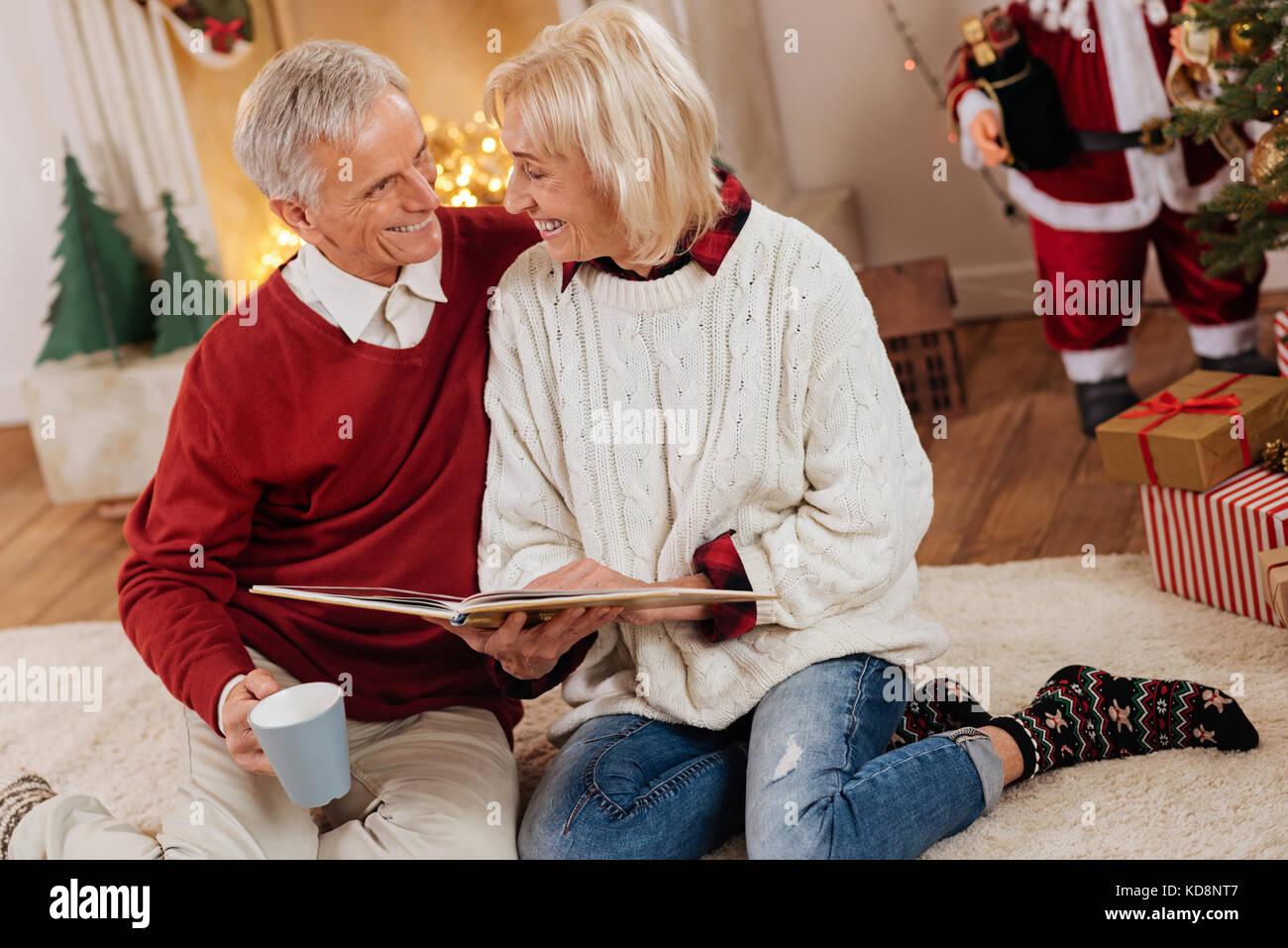 Elderly woman wearing funny socks Stock Photo