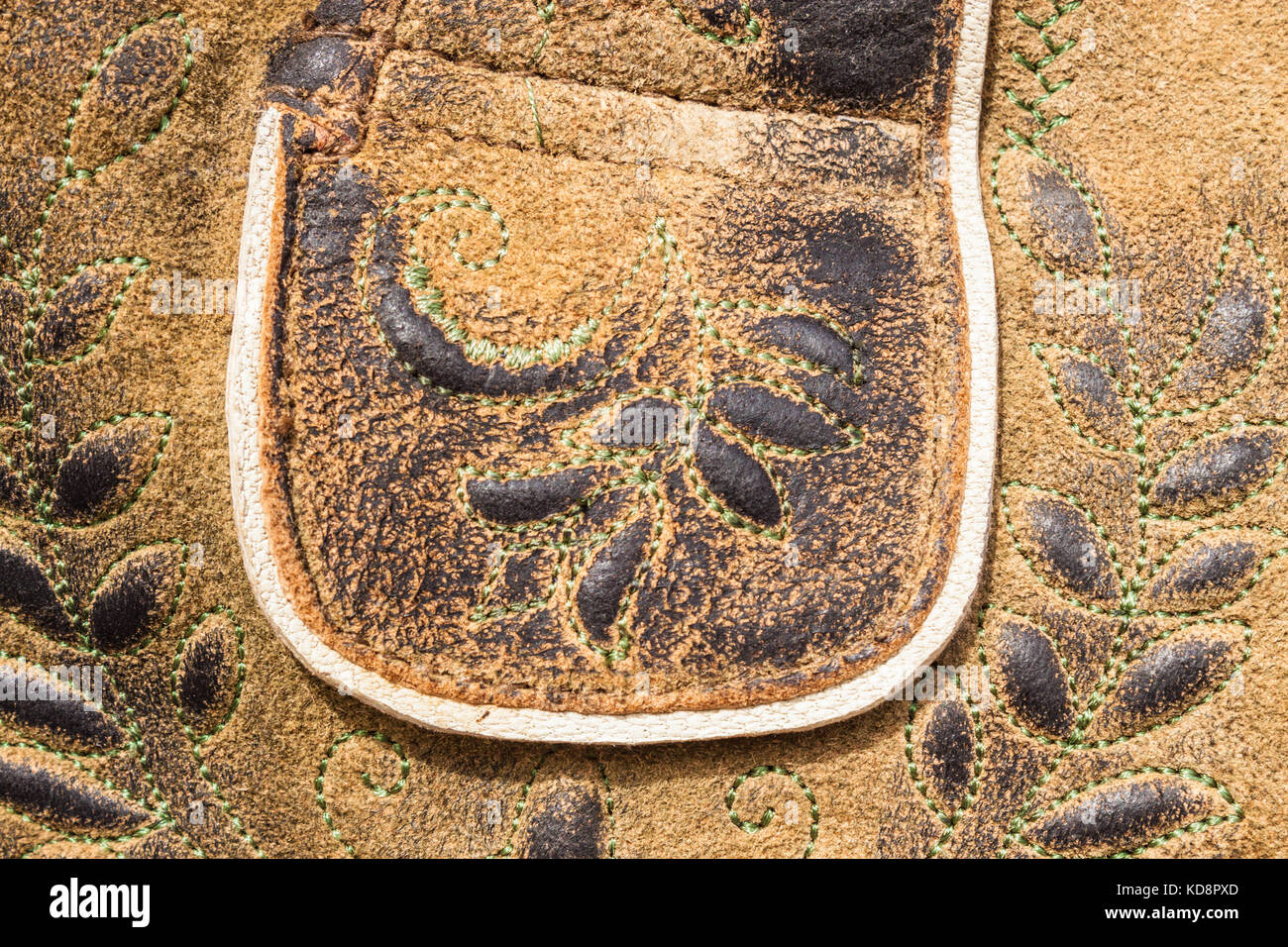 Closeup of traditional bavarian and austrian lederhosen (leather pants). Lether relief and embroidered ornament. - Stock Image