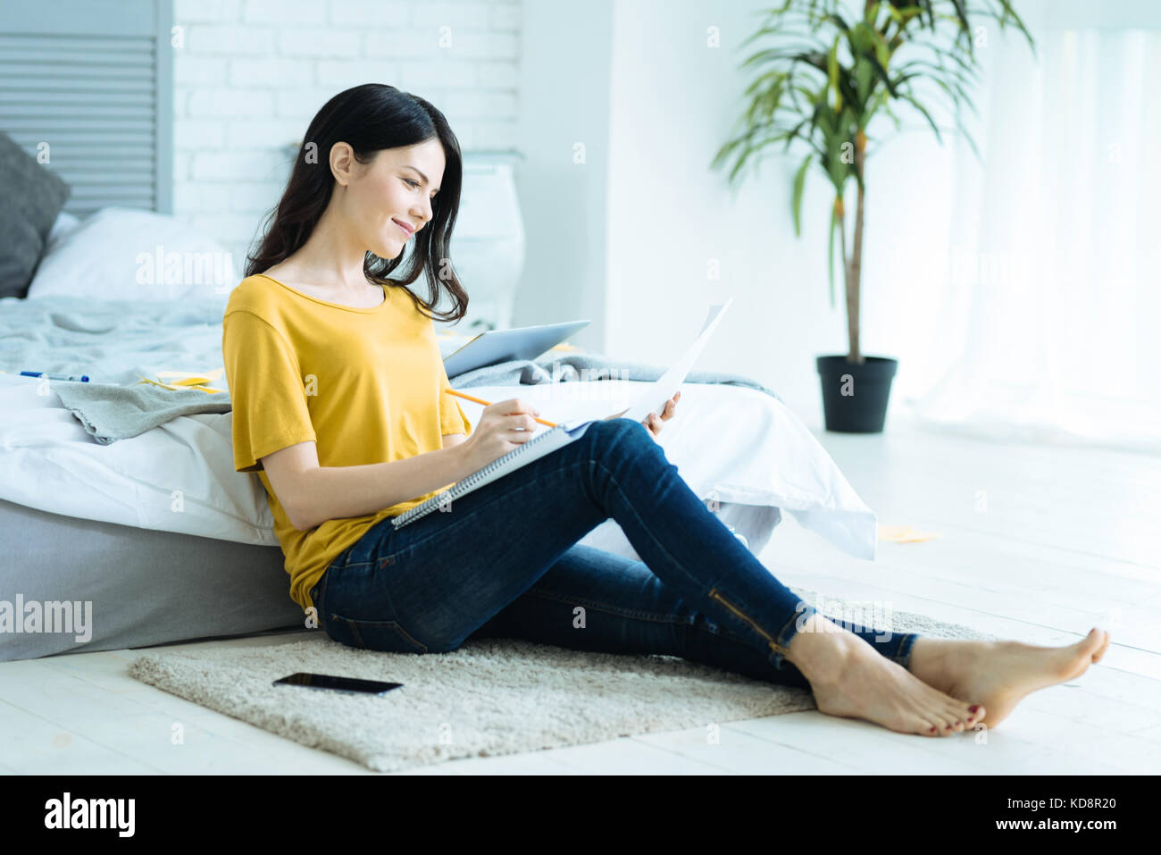 Relaxed self employed lady working from home - Stock Image