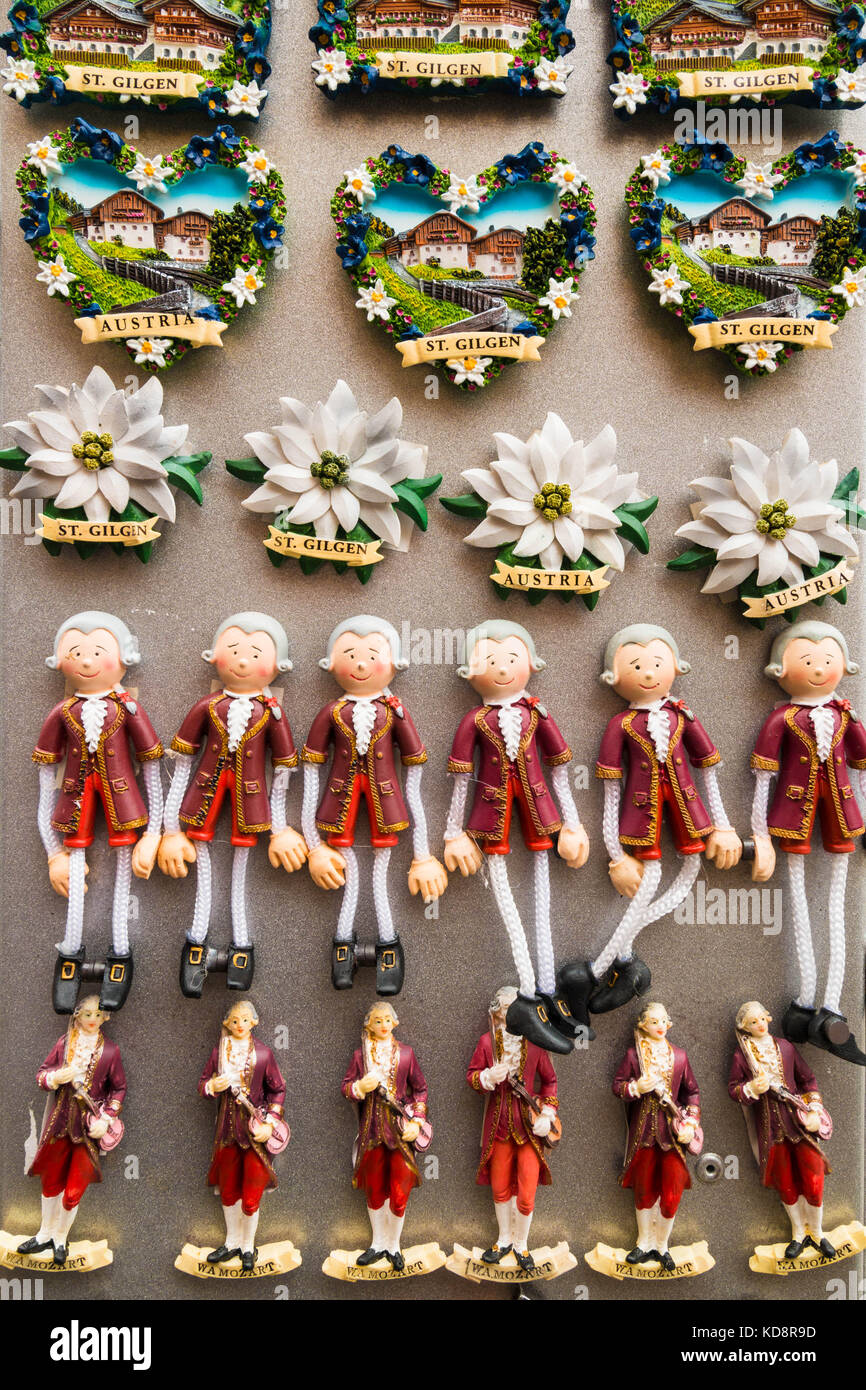 St. Gilgen, Austria - August 22, 2016: Travel souvenir magnets with typical austrian themes - Mozart, edelweiss - Stock Image