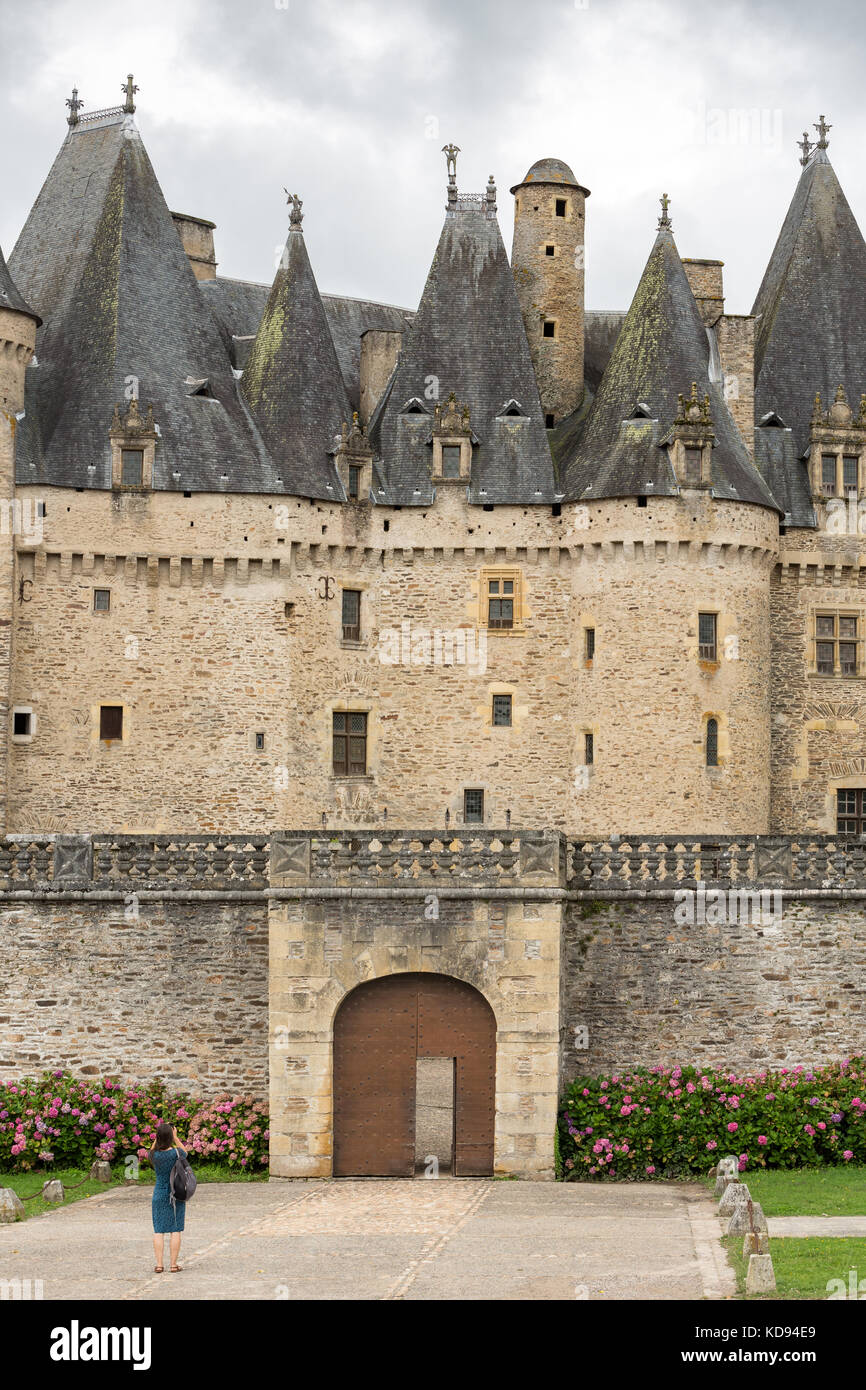 JUMILHAC-LE-GRAND, DORDOGNE, FRANCE: JULY 1, 2017: Female tourist photographing the large chateau or castle of Jumilhac - Stock Image