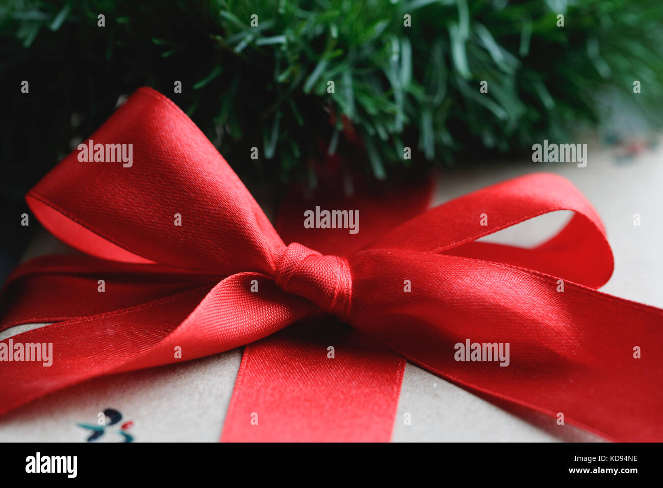 Close-up of a red bow on a gift box. Christmas concept. - Stock Image