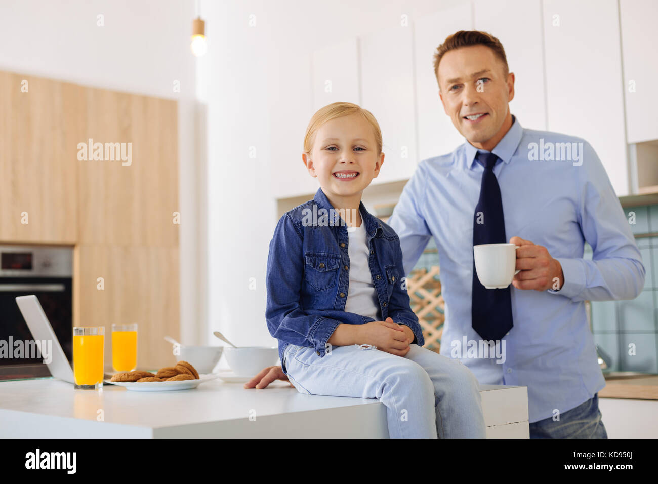 Nice handsome man holding a cup with coffee - Stock Image