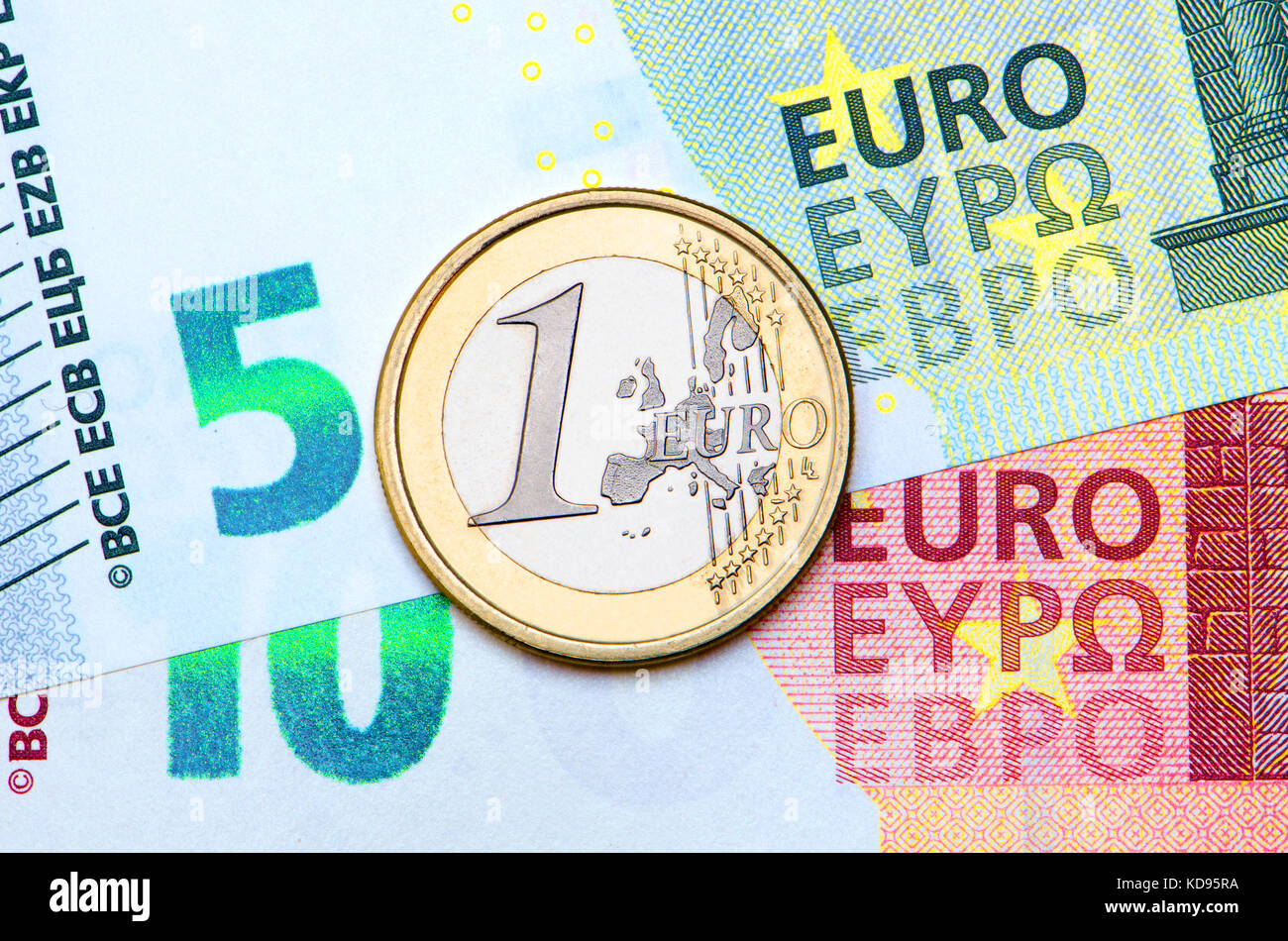 1 Euro coin on 5 and 10 Euro note - Stock Image