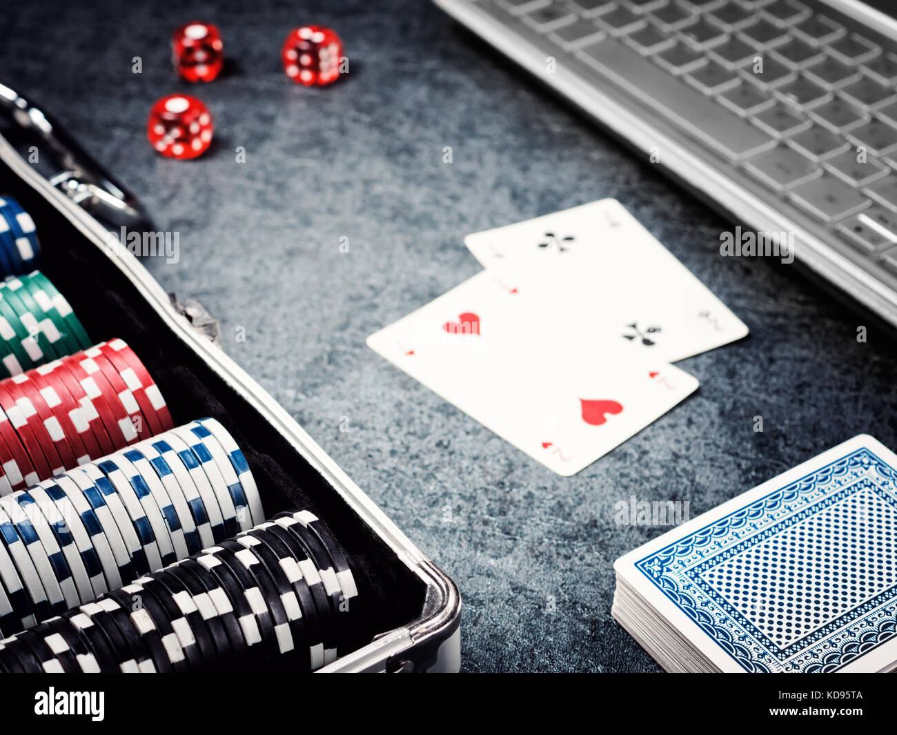 Set of poker chip or counter with card, dice in metal case and computer. Stock Photo