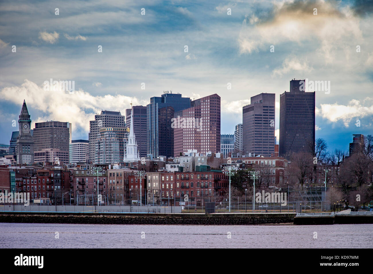 Evening view of Boston's North End across Charles River from Charlestown, Massachusetts, USA - Stock Image