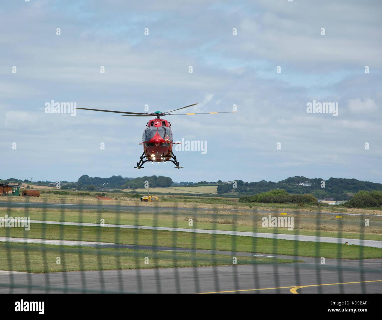 The Wales Air Ambulance Eurocopter EC145 landing at Caernarfon airport - Stock Image