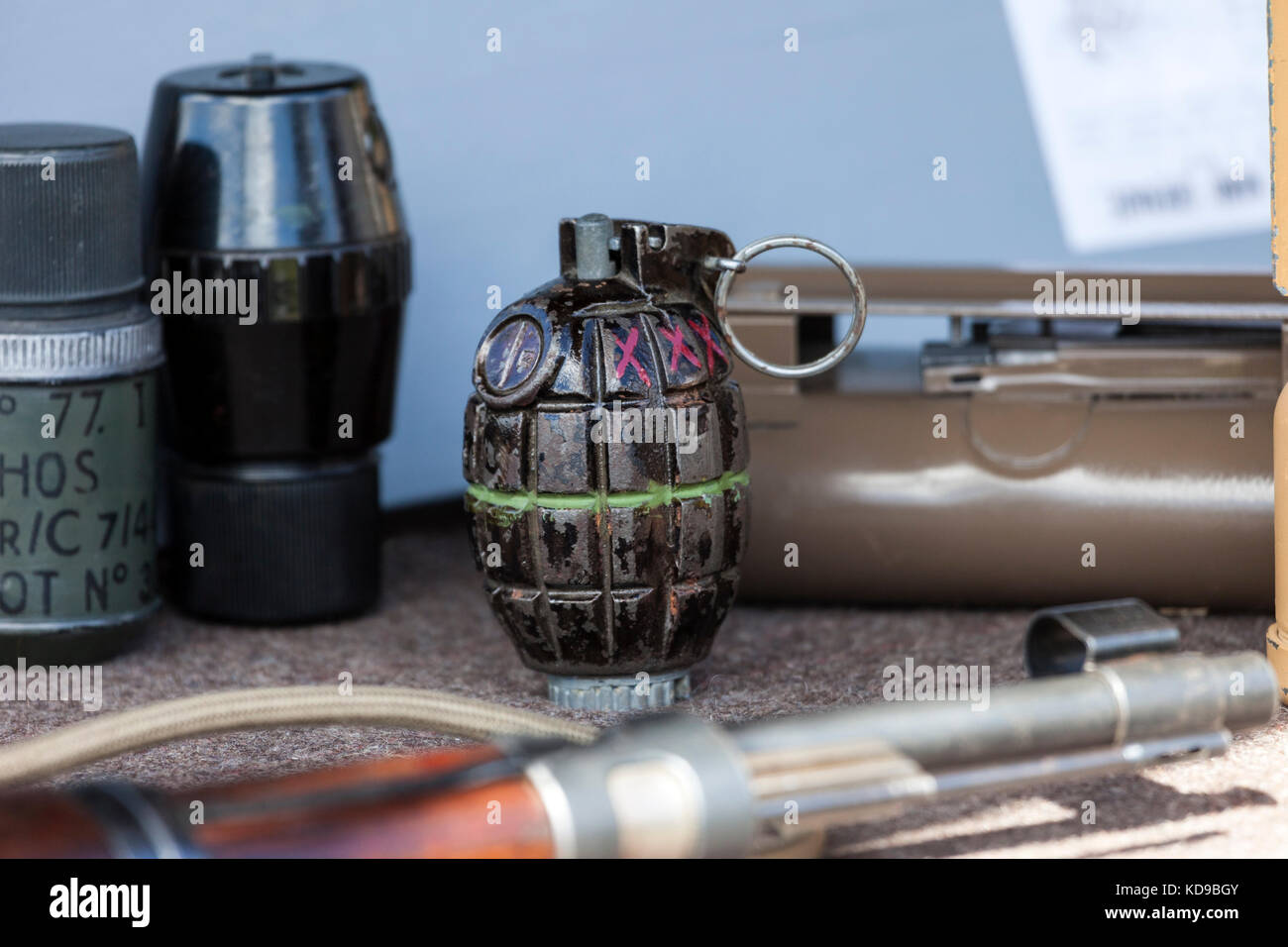 WW2 Hand Grenades and other Weapons, with a British Hand Grenade (Mills Bomb) Centre Pic, UK. - Stock Image