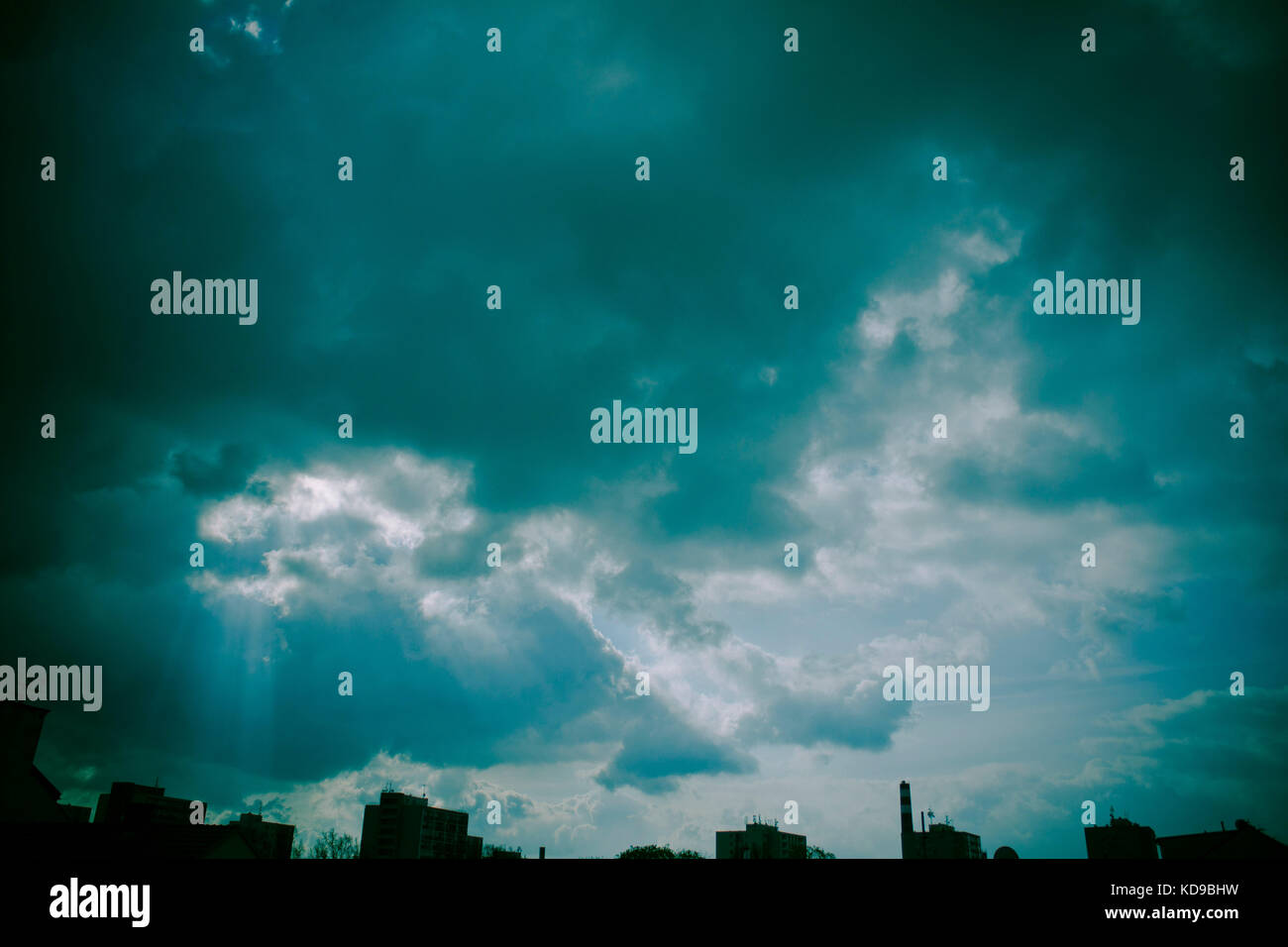 mystical cloudy sky over the city silhouette Stock Photo