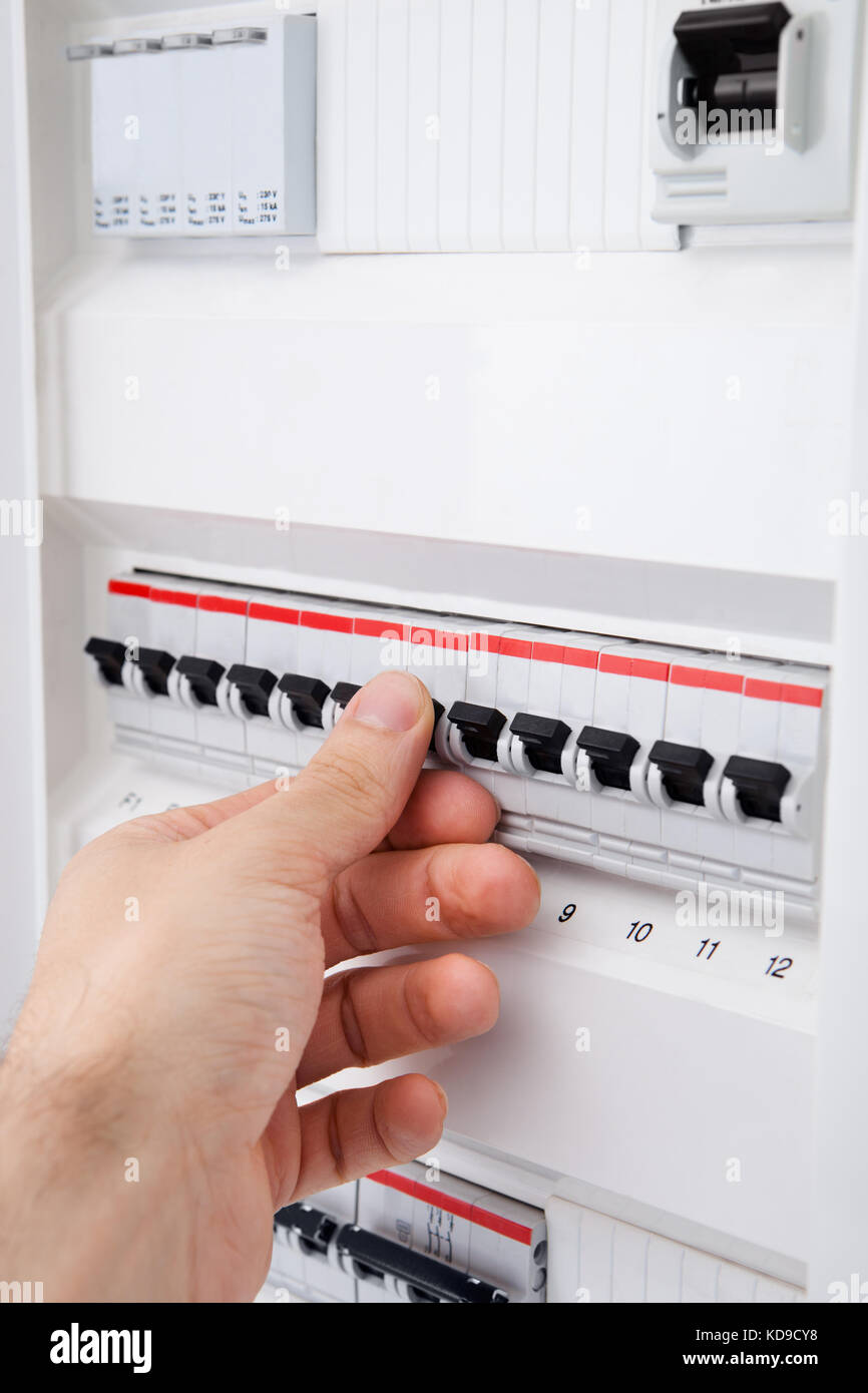 Short Circuit Still Stock Photos Images Appliances Close Up Of Hand On Switch Distribution Board Image